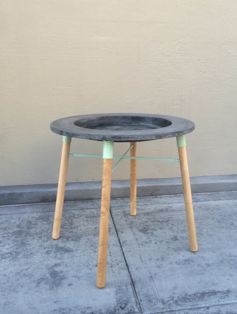 Concrete, aluminum and maple table.