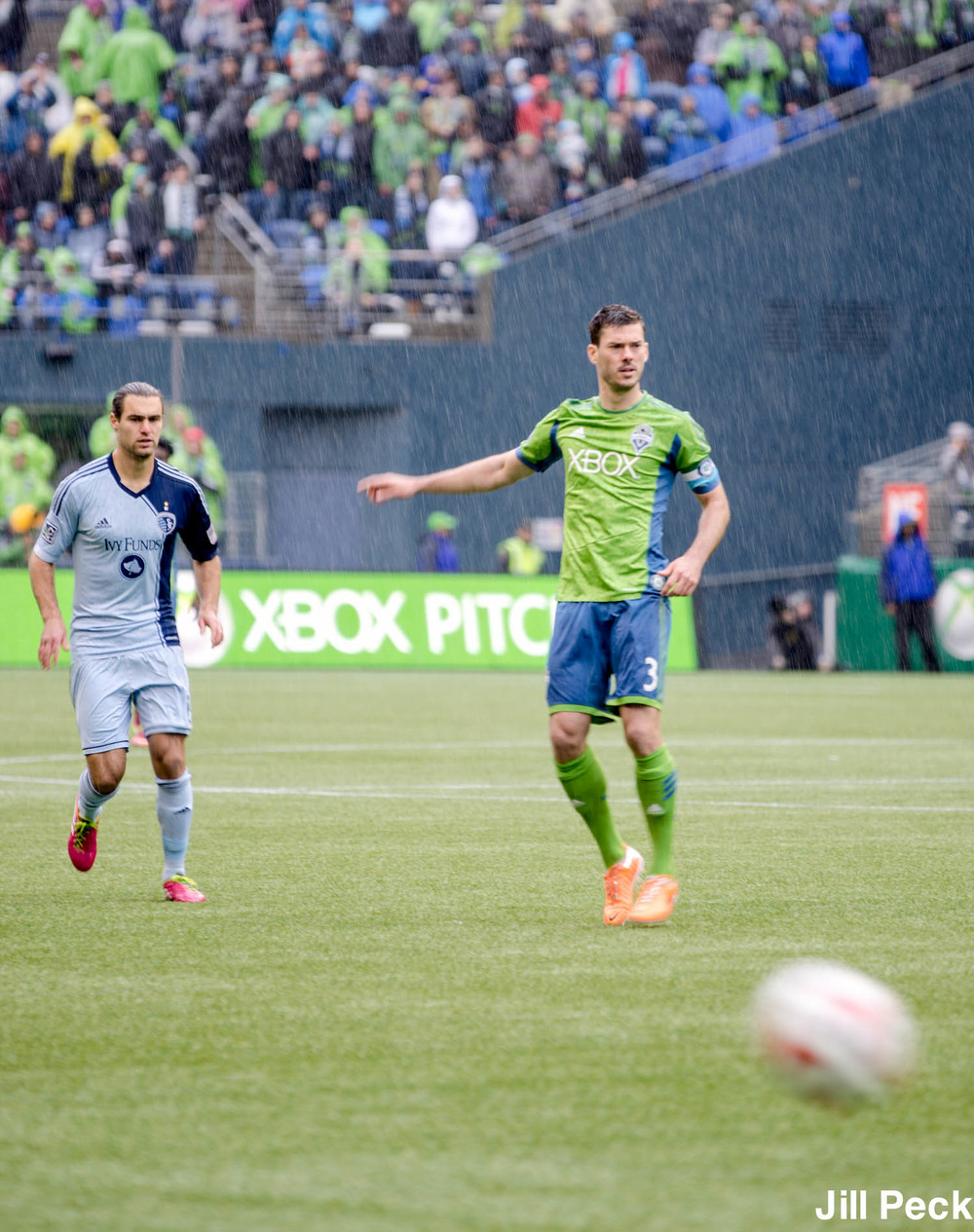 Graham Zuzi of Sporting KC and Brad Evans of Seattle Sounders FC