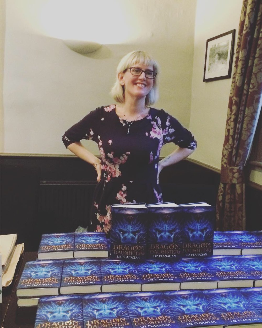 Liz at launch with bookstall - a dream come true for this bookworm!