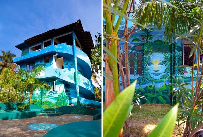 The main hotel building of The Mandala with a view of artwork mural on the side of the building
