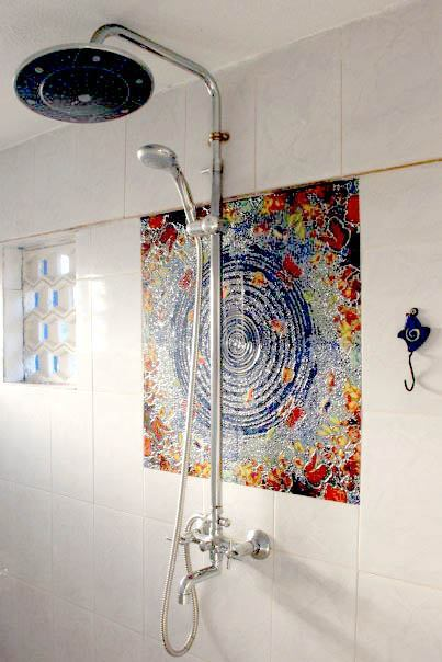 Shower and tile mural inside Panomandala suite