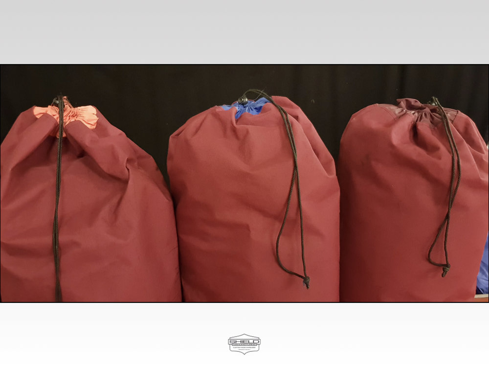 Our marquee lining bags have a common theme, the main bag colour for a given width structure is the same.