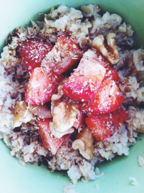 flaxseed sprinkled on oatmeal with strawberries and walnuts.. mmm mmm