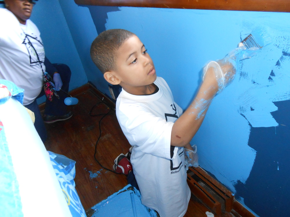 Little Cameron working on his room.JPG