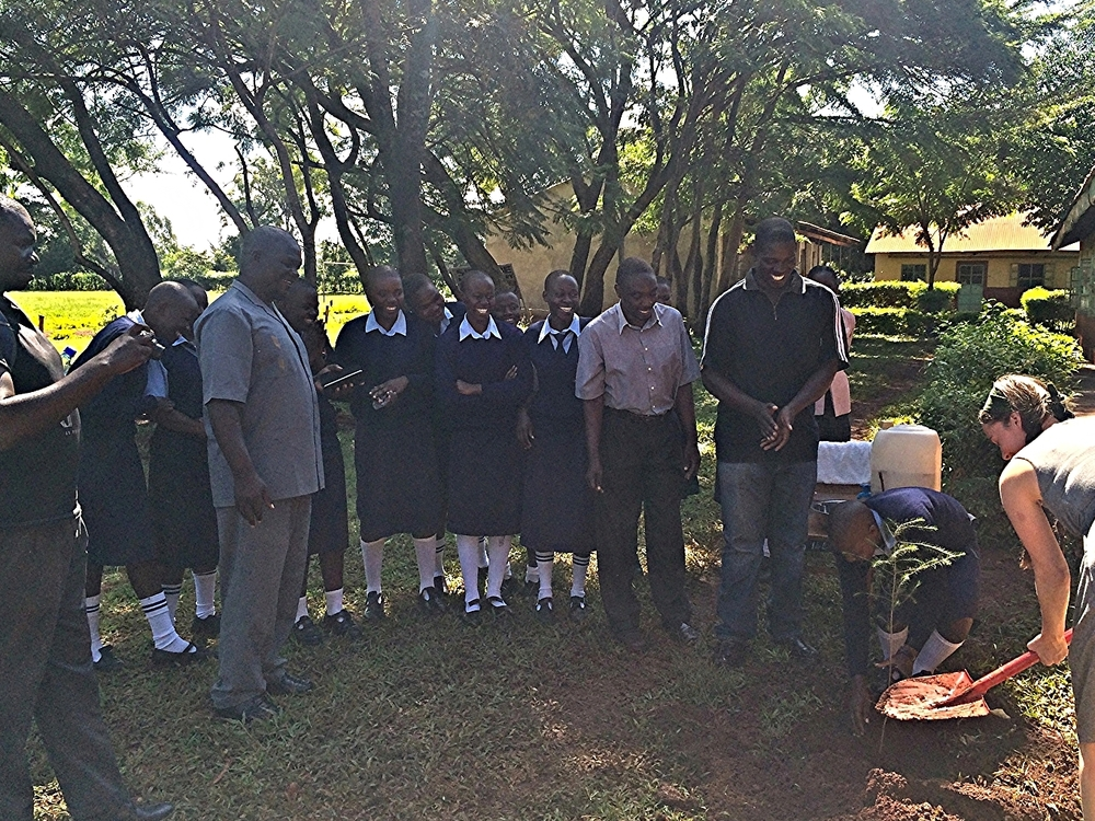 Mr. Airo and his Senior Girls and Sirembe Secondary School.