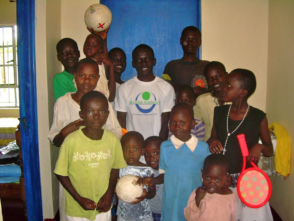 August 4th, 2010 -- Day 3 of living at JCO--Our first ten kiddos with a few friends, including Vincent (Our RH Scholar right in the middle)