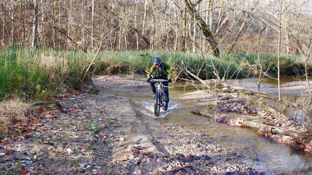 Eric fat biking one of the creeks at Caesar Creek.
