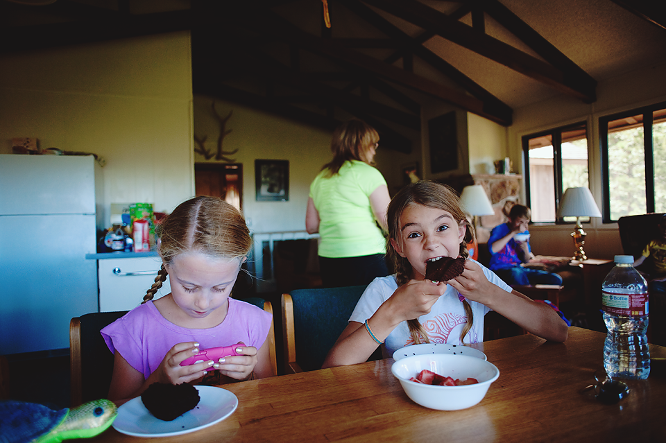 "My younger daughter and her ""best cousin"" having snacks after mountain camp...chocolate muffins and strawberries. YUM!"