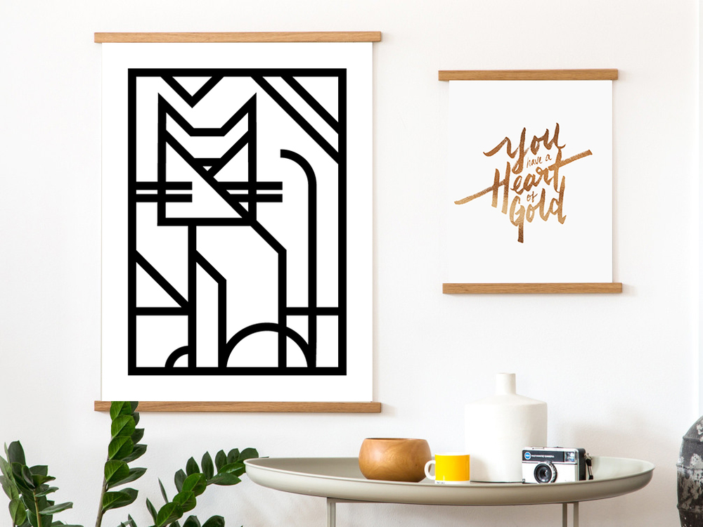 """Geometric Kitty"" print and ""Heart of Gold"" 8 x 10 print, both held by our wooden art holders."