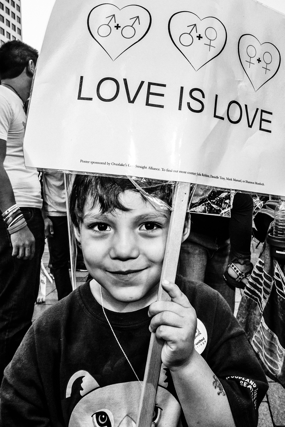 A boy holds a sign at a March for Marriage Equality rally in downtown Seattle on October 6th, 2012.