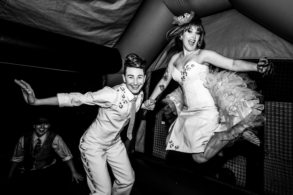 "Susanna Raphael Wellbourne and Ricki Mason, better known by their stage names Kitten and Lou, enjoy a moment in a bouncy house after tying the knot in an extravaganza of glitter and balloons in Seattle on July 28th, 2013. The burleque performer and drag queen are self-proclaimed ""The World's Show-Busiest Couple!"""