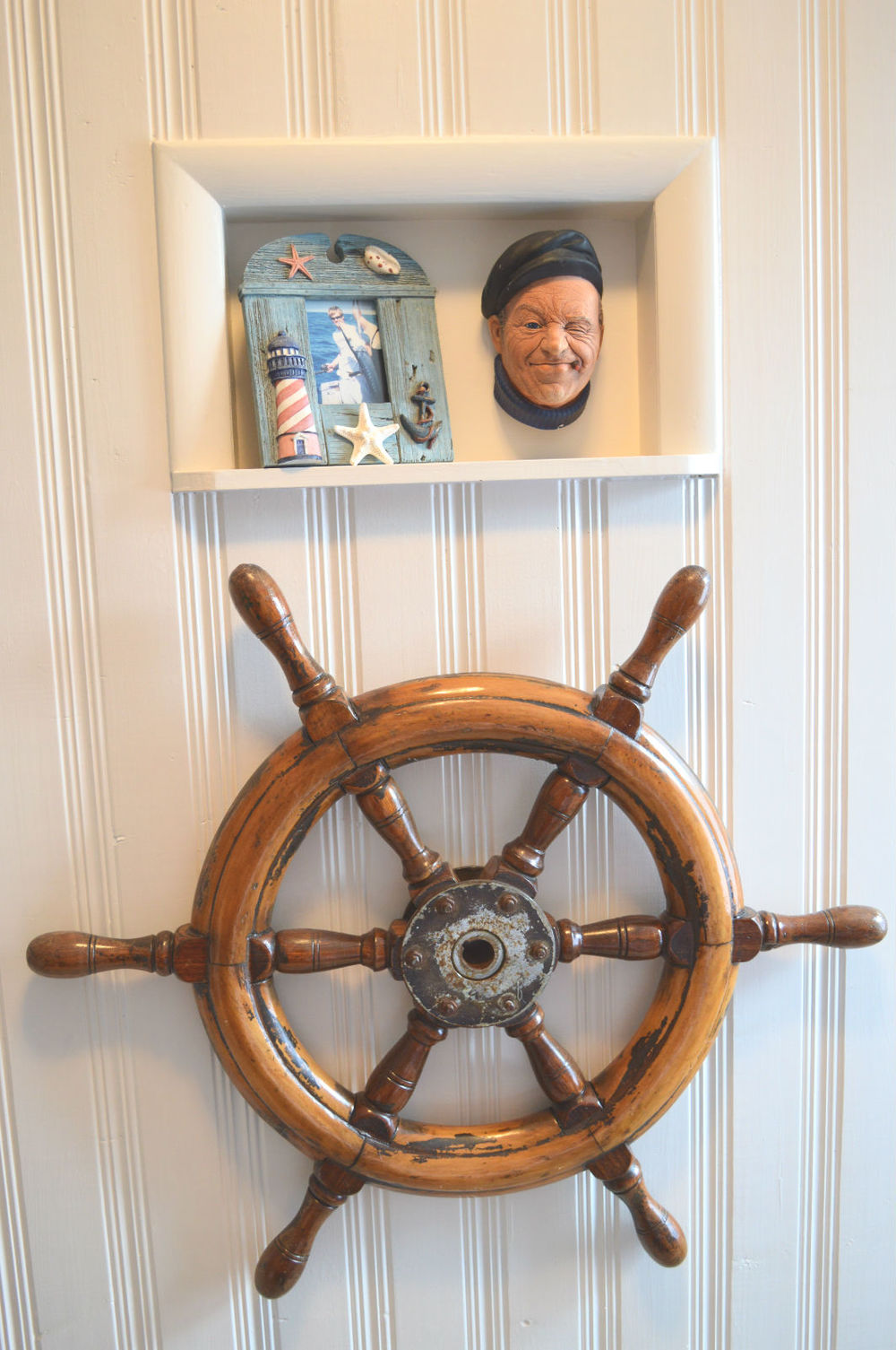 Bosson captain head inherited...old captain's wheel from an antique sale.