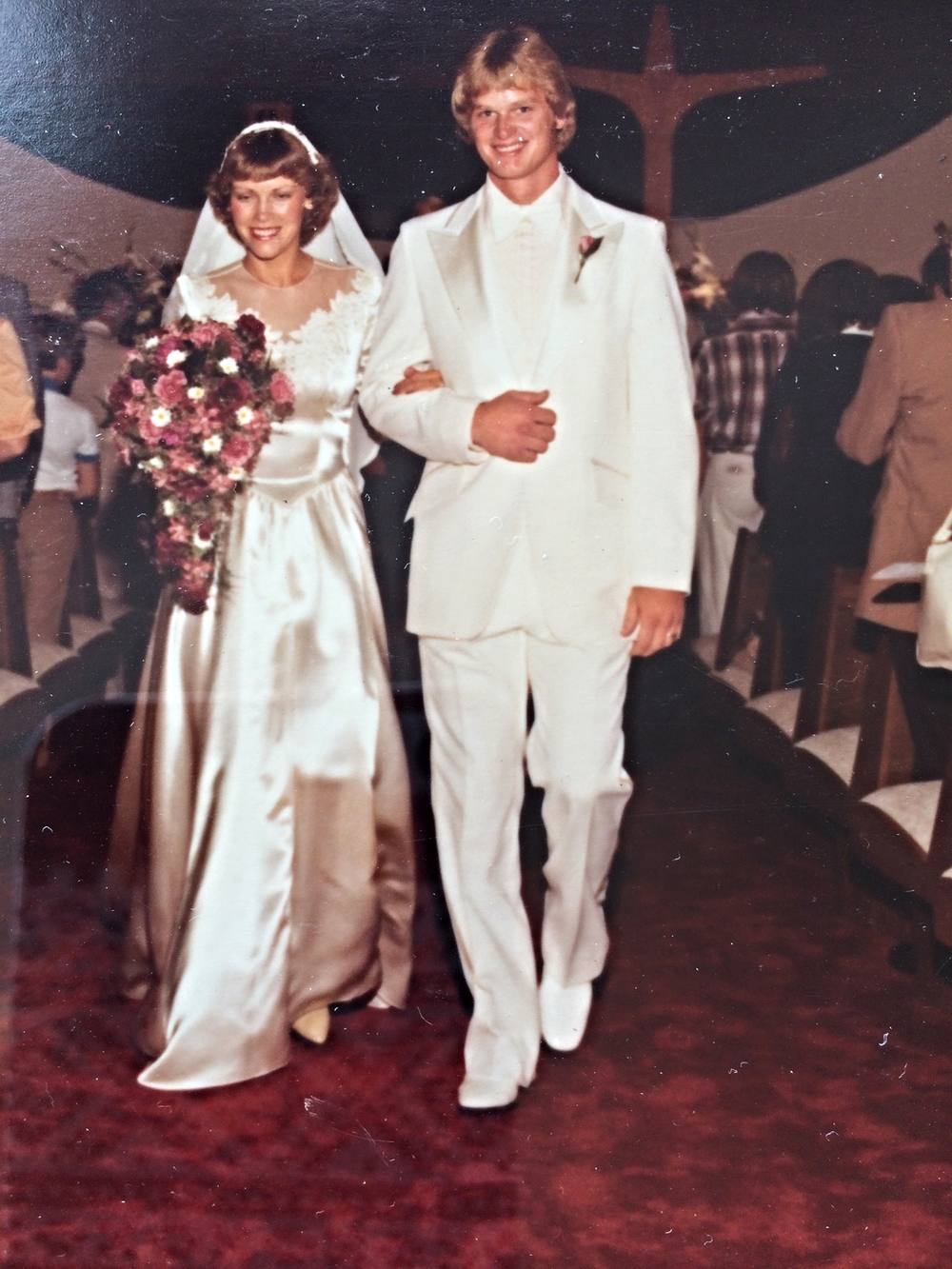 Love the 80's perm?!! The white tux?!!