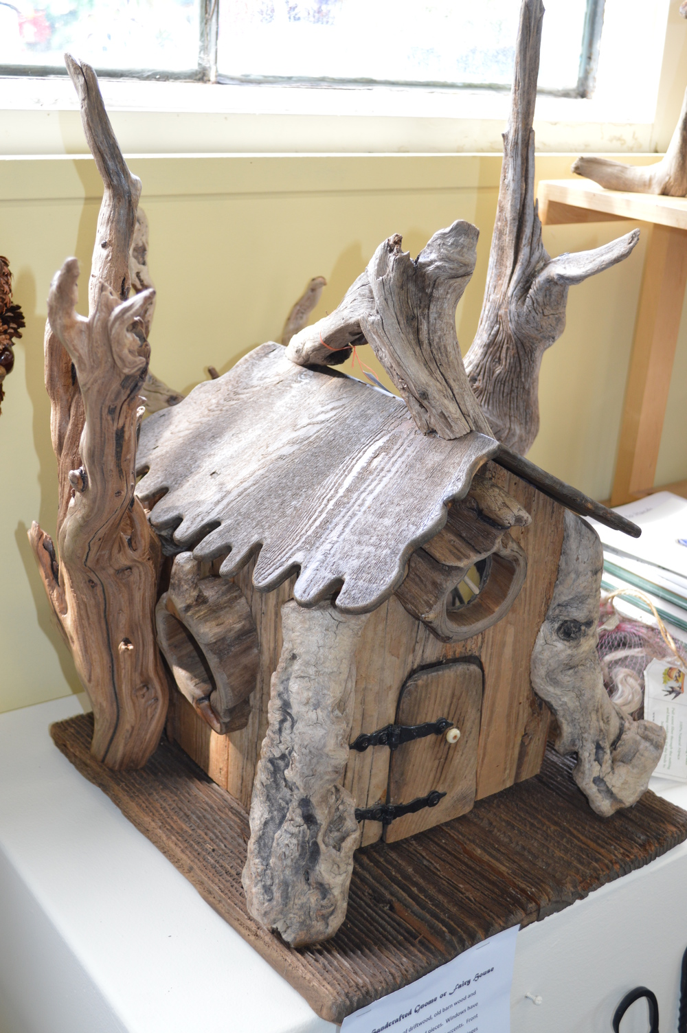 How cute is this little driftwood house...