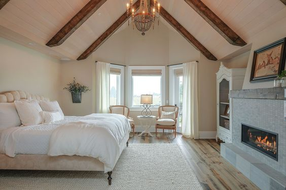 Master bedroom...love the open beams and fireplace! (pinterest)