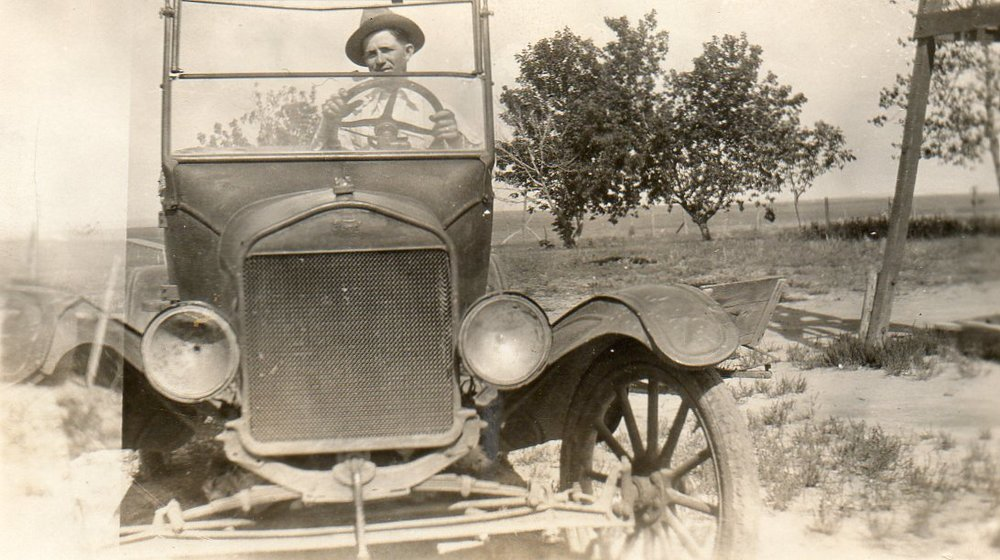 "Grandpa Howard and his   ""bran-new green-spring wagon, with the wheels striped red and yeller."""