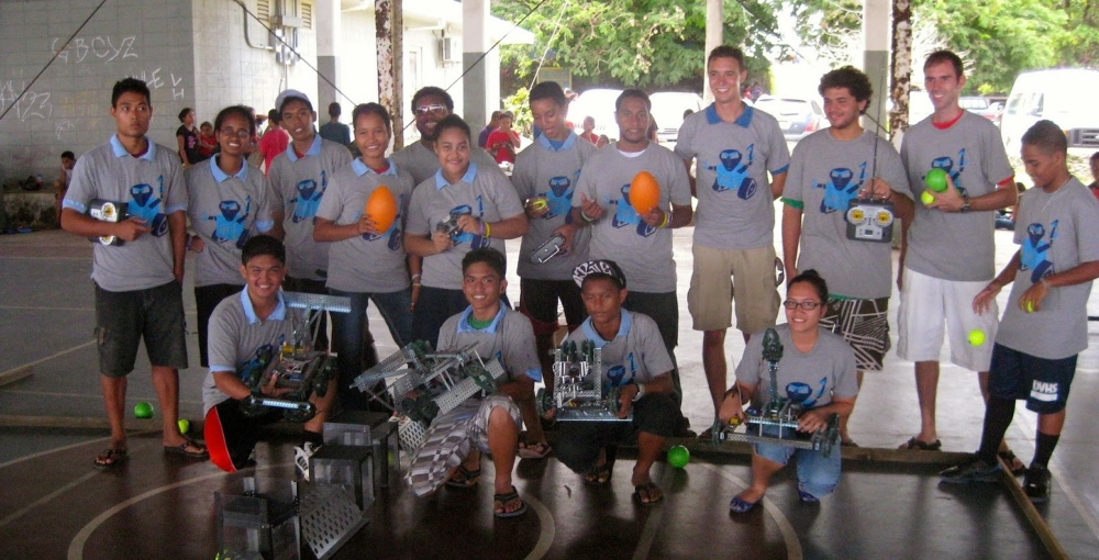 Student team pose with their robots