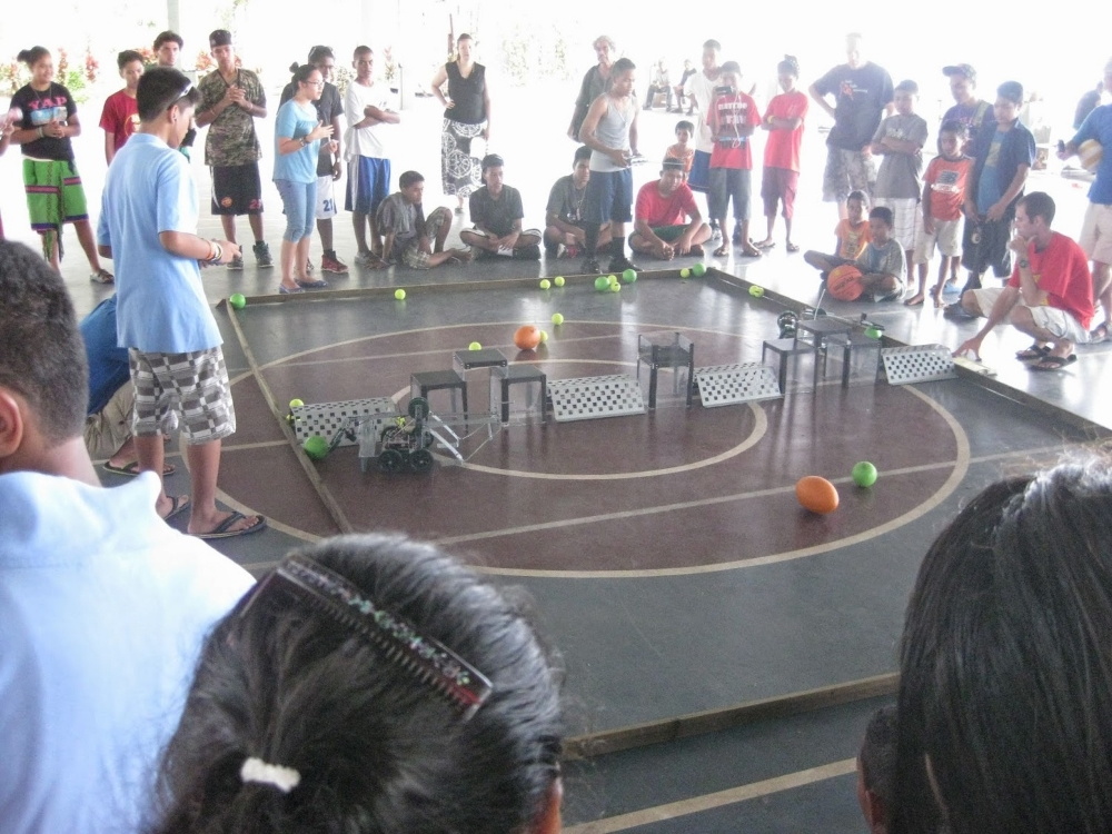 Yap Catholic and SDA School robots battle to push as many balls over the wall before the buzzer