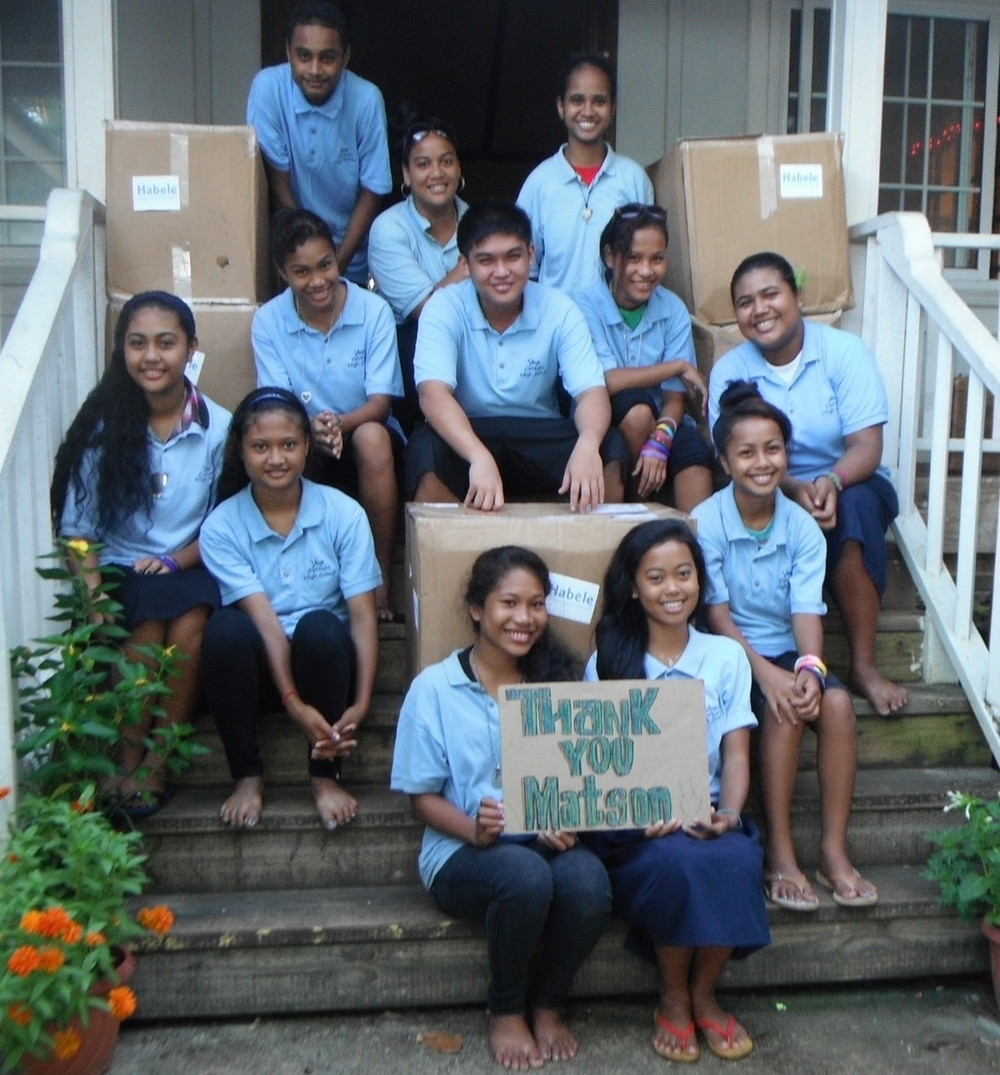 Students at Yap Catholic with boxes of donated robotic equipment facilitated by Matson