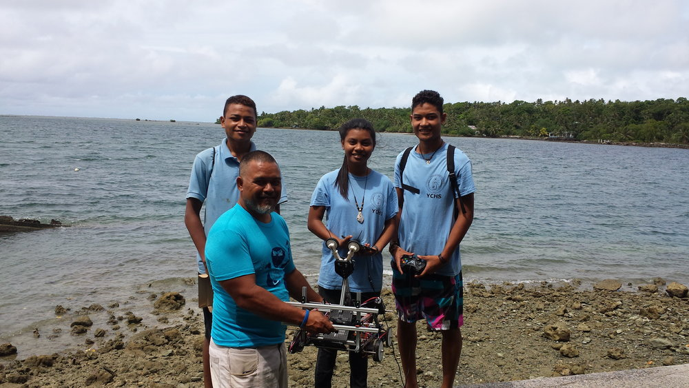 Natasha Loochaz, John Steven Gilinug, and Francis Yarofalyango of Micronesia's Robotics Team with Mr. Larry Raigetal.