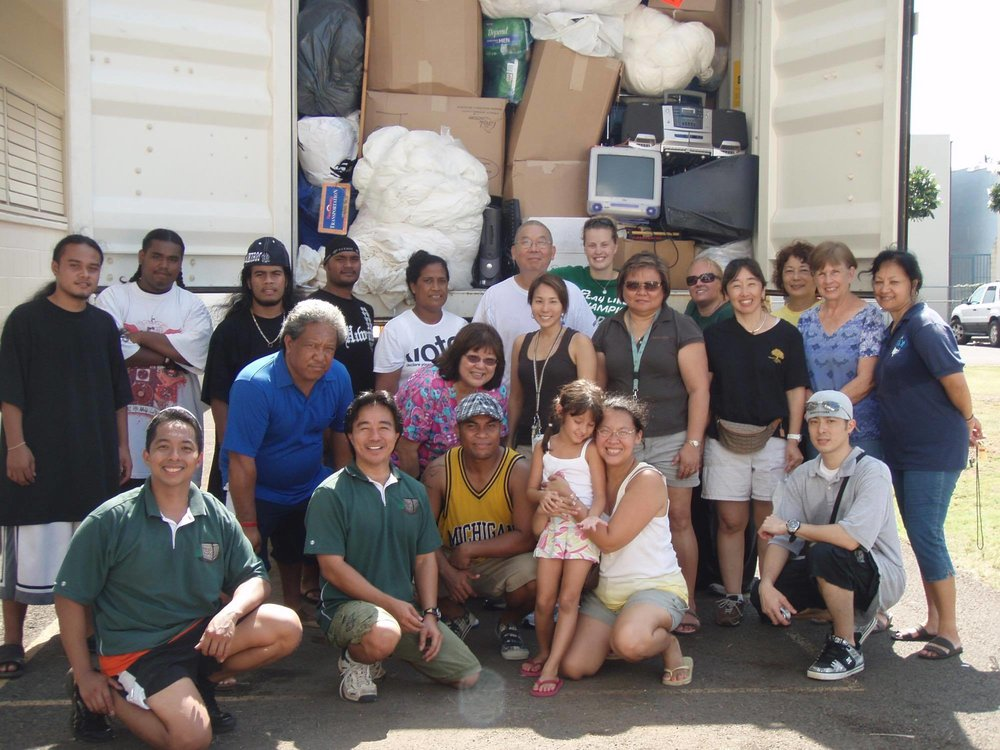 Senator Wakai (2nd from bottom left) with a group of volunteers after filling a container of donated goods bound for Chuuk.