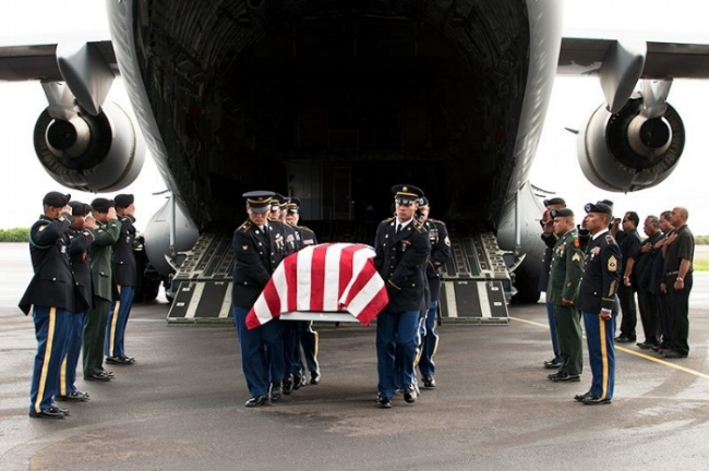 The body of Sgt. Sapuro Brightly Nena, arriving in Kosrae.