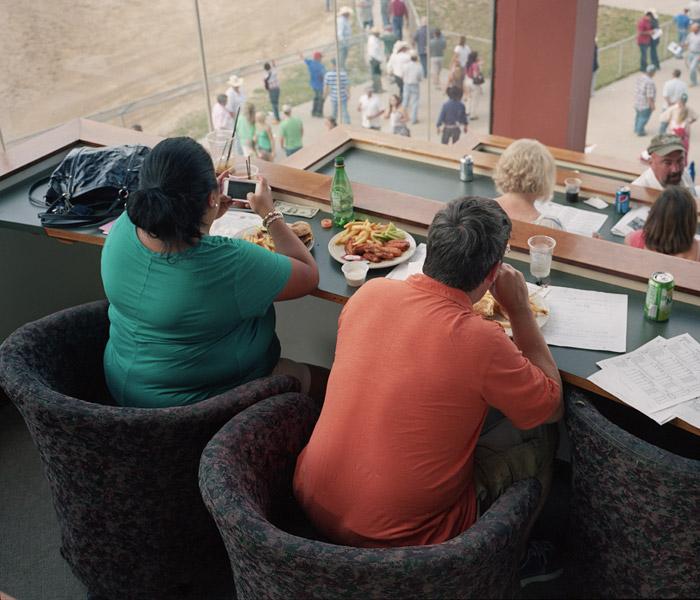 Spectators eating at a horse race.    DENVER, CO 2013