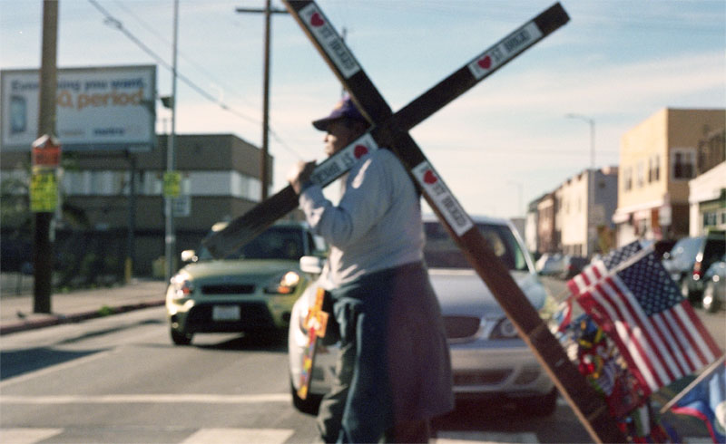Man carrying a cross in South LA. Los Angeles, CA 2013