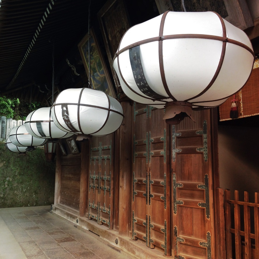 Lanterns outside Nigatsudo Hall overlooking Nara