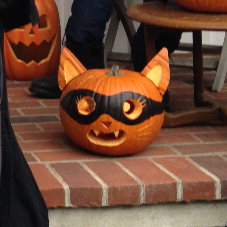 in a kids halloween world cat inspired me to make that jack o lantern too with a little bit of black paint and some toothpicks to hold the ears on it