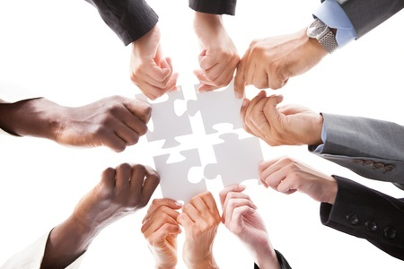 21668369-close-up-photo-of-businesspeople-holding-jigsaw-puzzle.jpg