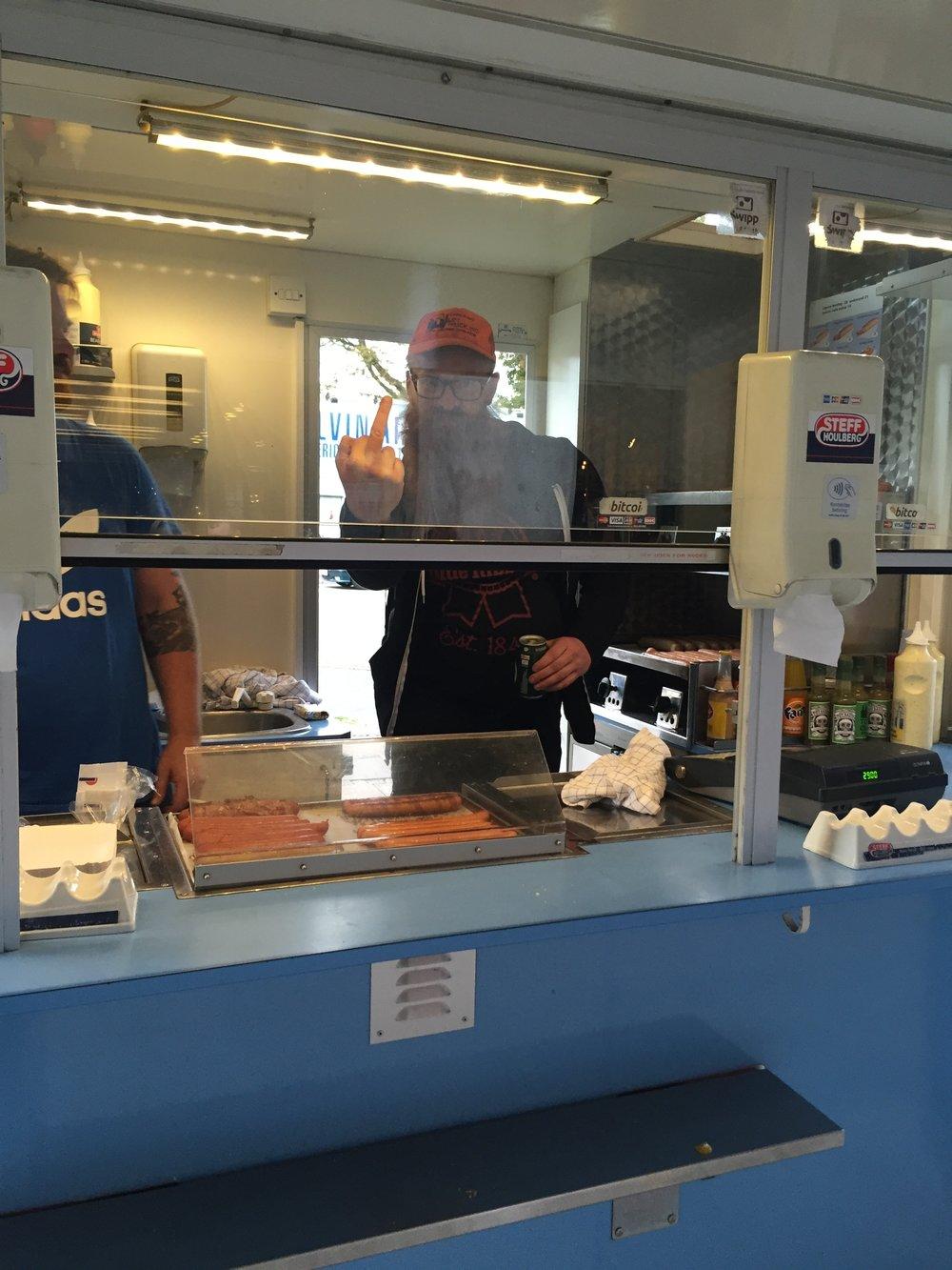 Joe inside Hot Dog John's hot dog stand.