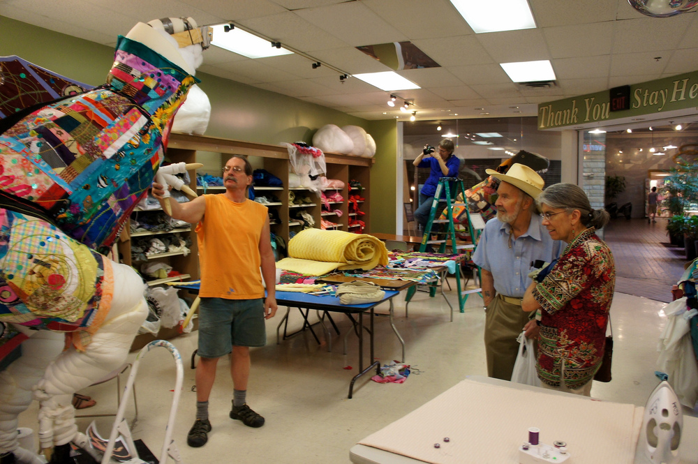 Robert talking with visitors. The studio and artwork was an unexpected treat for many community members visiting the mall.