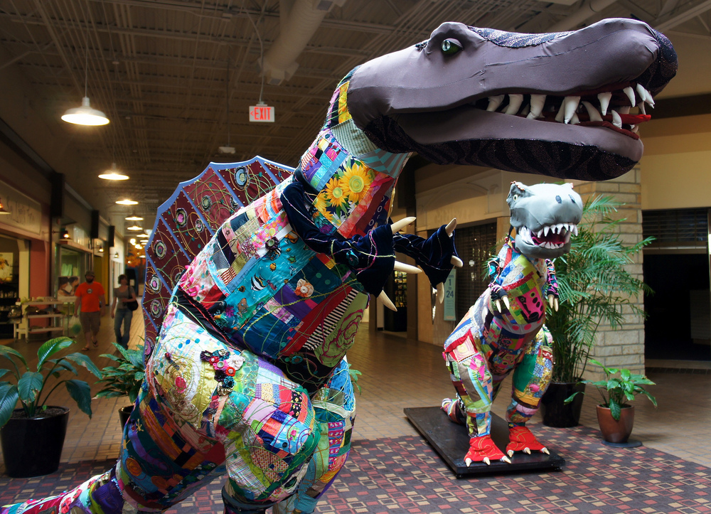Two quilted dinos created and installed at a mall in Athens, Ohio.