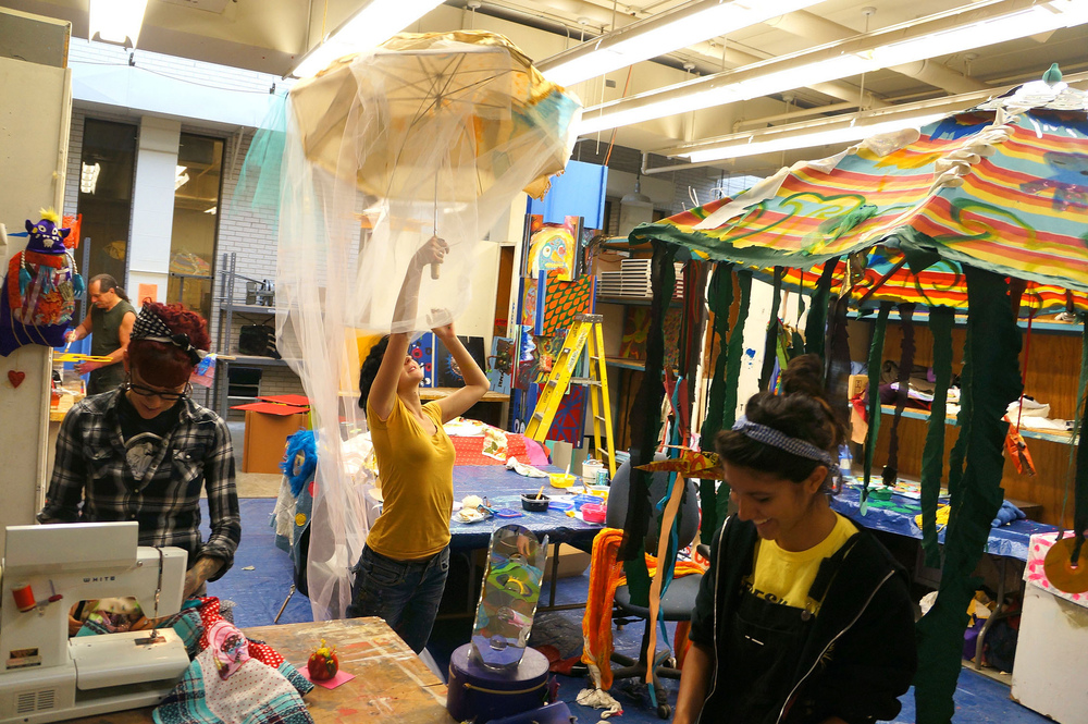 Volunteers exploring materials and building the Palace of Wonder in the public studio space at MCAD (Minneapolis College of Art and Design).
