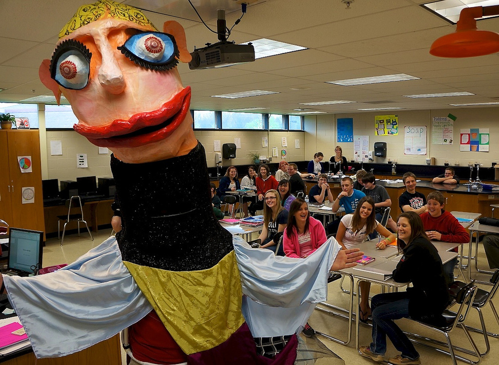 Celebration Day/last day of the residency: One of the high school students wearing a giant puppet and visiting classes throughout the building.