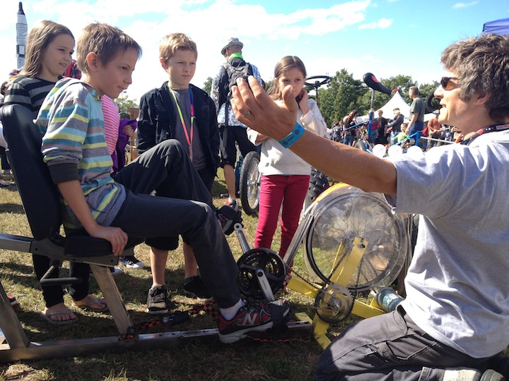 Andy demonstrating our machines to kids at the 2013 Maker Faire in New York City.