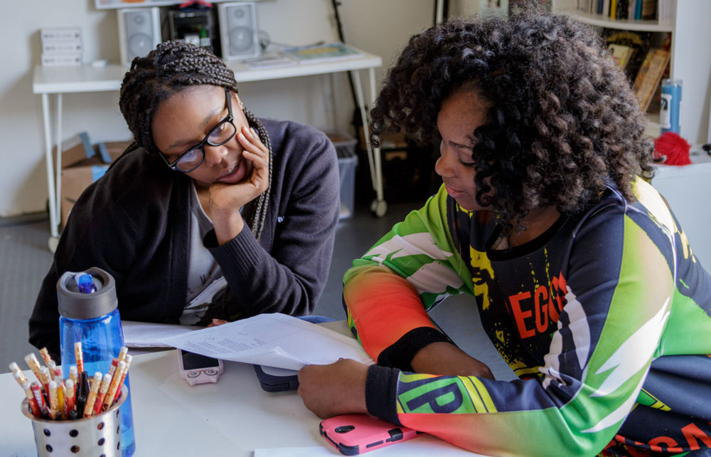 Big Class Poetry interns Christiann Cannon, left, and Anyx Burd read over a poetry submission for the upcoming Pizza Poetry day in New Orleans. Big Class will publish poetry on pizza boxes this Friday. Advocate staff photo by LESLIE GAMBONI