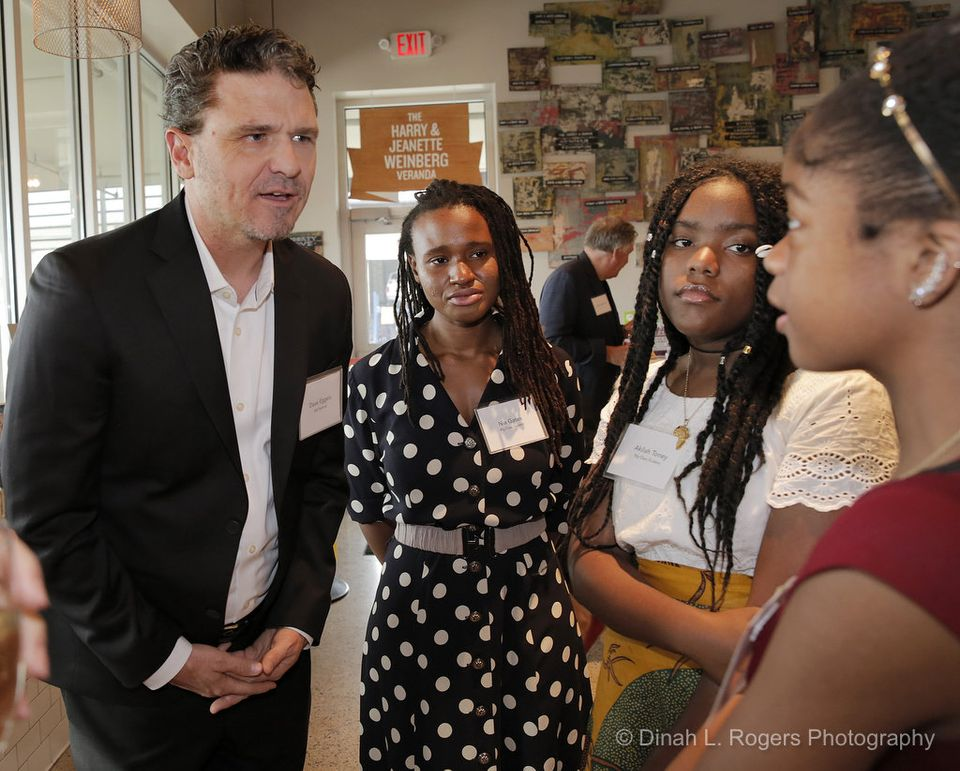 Author Dave Eggers chats with students Nia Gates, Akilah Toney and Amaya Smith at a benefit for New Orleans's Youth Writing Center Thursday (May 18) at the Goldring Center for Culinary Medicine. (Dinah Rogers Photo)