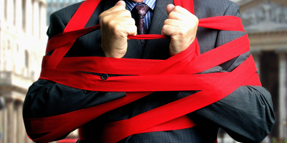BUSINESSMAN-RED-TAPE.jpg