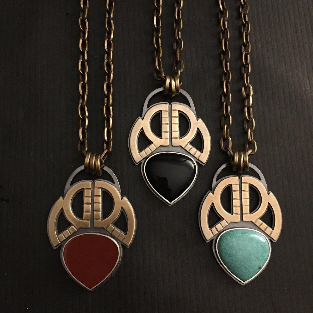 scarab necklaces.jpg