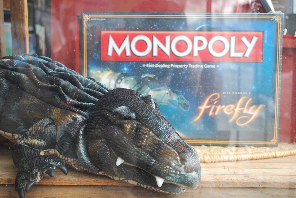 Monopoly Firefly guarded by a Folkmanis Alligator