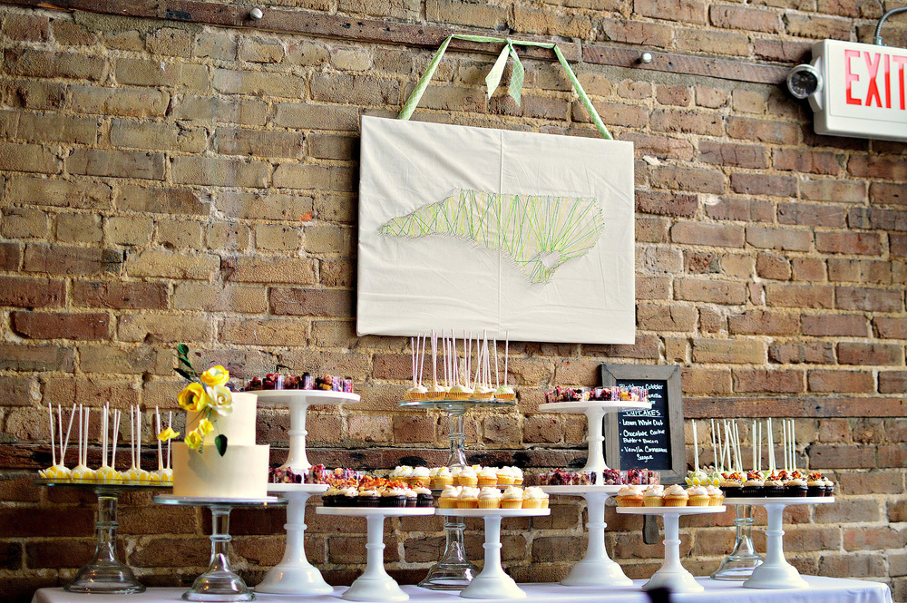 Reception was held at  128 South Events & Catering :  The couple choose a full Dessert Table along with a beautiful cutting cake, to provide their guests with different tastes and bites.    Wedding Cake:  Chocolate with Peanut Butter Buttercream,   Cupcakes: Lemon WhiteOut, Vanilla Cinnamon Sugar,, Chocolate Cookie Butter w/Bacon  Truffle Pops:  Chocolate & Vanilla  Cobbler: Blackberry