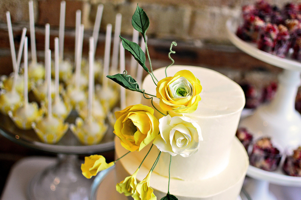 Wonderful Handmade Cake Flowers  were created to match some of the selected flowers of the wedding.  Flowers:  Ranunculus, Open Rose, Sweet Pea