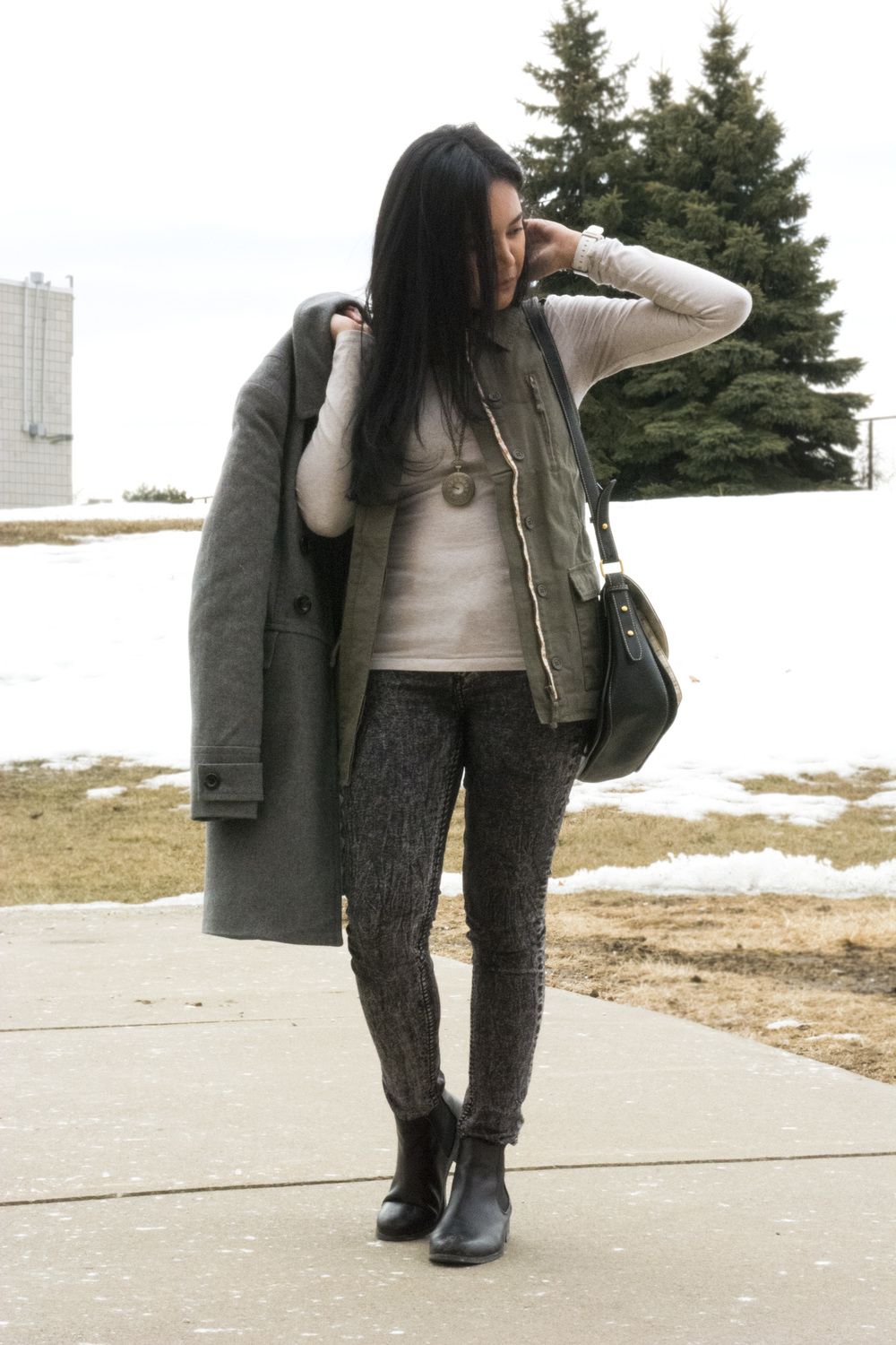 Josie Bako wearing anO'niell vest, Old Navy jacket, Forever 21 long sleeve shirt, H&M pants, Topshop ankle boots, thrifted necklace, and shoulder bag from Indonesia.
