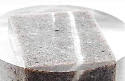 30 mm polished resin puck of a sandstone block.