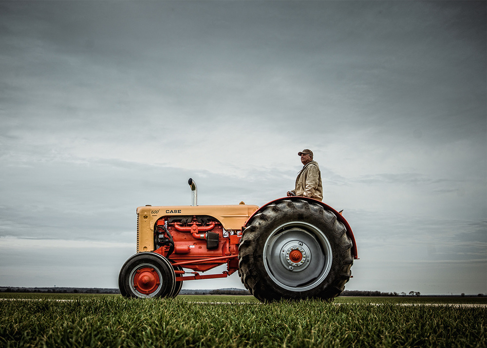 Photographer: Andy Mahr.  Frank Wurzbach riding classic Case tractor.
