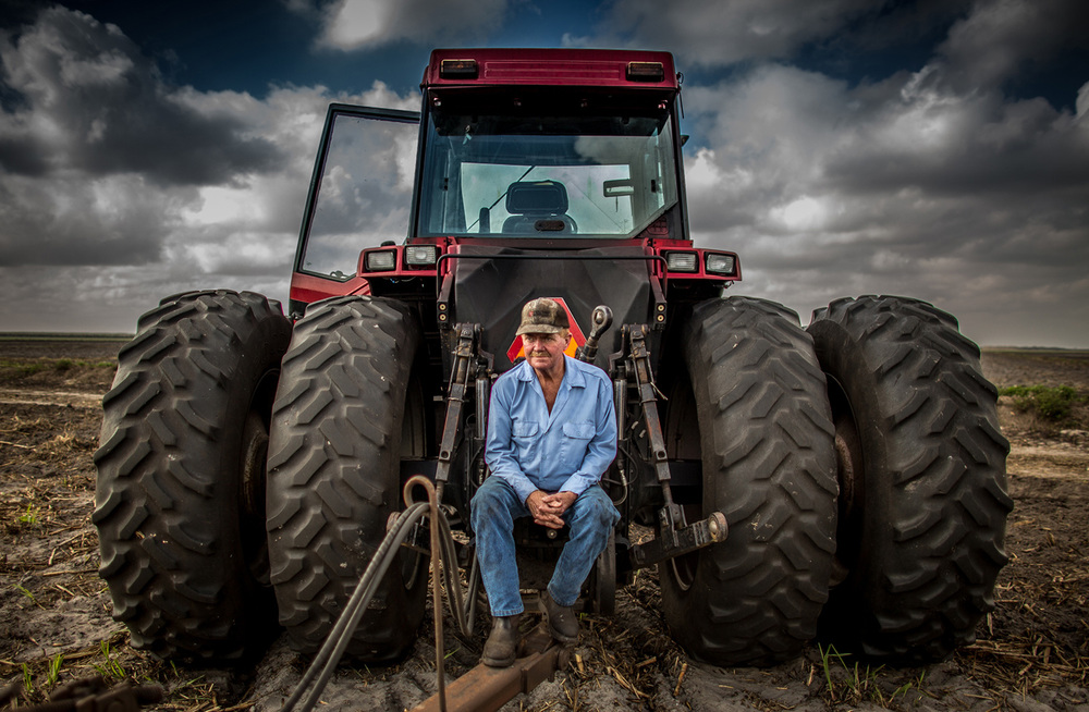 "Photographer:  Mark Gooch. Paul""Barney"" Bowden, taking a break from plowing under stubble cane."