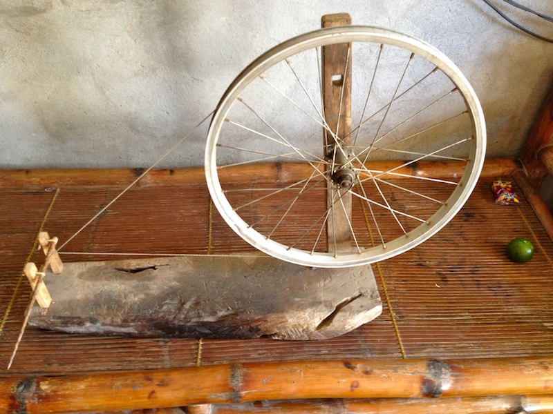 The first step of the weaving process is spinning the yarn using this no-tech spinning wheel.