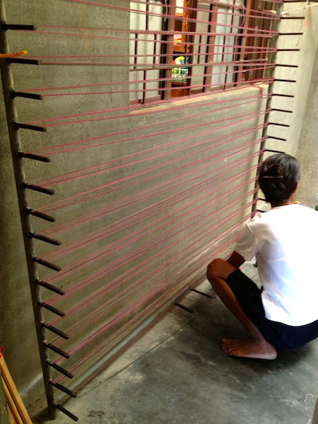 This determines the color combination of the finished textile. Only Aling Naty and this manang know how to do this step. They often get up at 2 AM so that all the weavers would have yarn to weave that day.